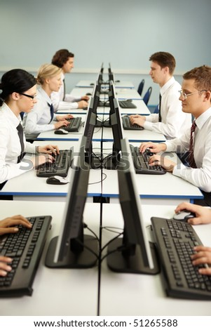 Image of businesspeople typing on the keyboards in line - stock photo