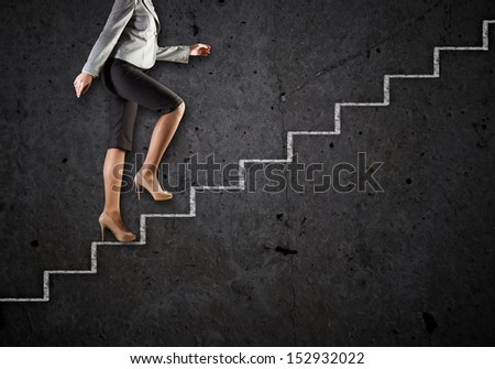 Image of businesswoman climbing career ladder. Success and achievement - stock photo