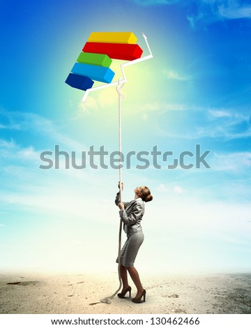 Image of businesswoman climbing the rope attached to diagram aloft - stock photo