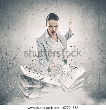 Image of businesswoman crushing with hand pile of keyboards - stock photo