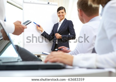 Image of businesswoman doing presentation to businesspeople during conference - stock photo