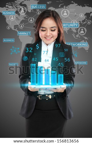 Image of businesswoman in black suit showing graph over world background - stock photo