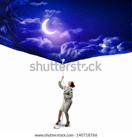 Image of businesswoman pulling banner with illustration. Day and night concept - stock photo