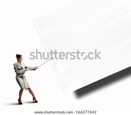 Image of businesswoman pulling blank banner. Place for text