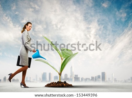 Image of businesswoman watering tree with pot. Ecology concept - stock photo