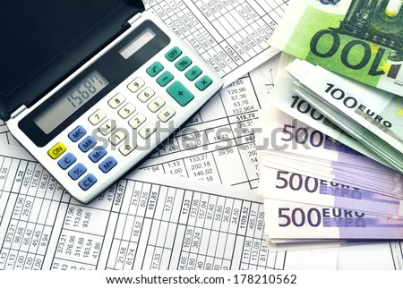 Image of calculator with money 100 and 500 euro/Money and calculator