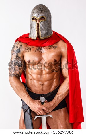 Image of calm warrior who is standing with his sword - stock photo