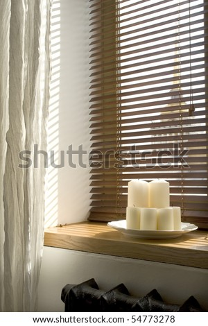 image of candles on a windowsill - stock photo