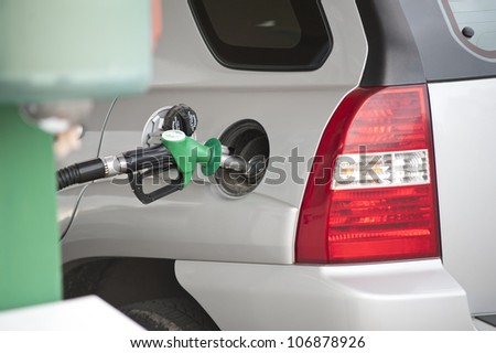 Image of car at gas station - stock photo