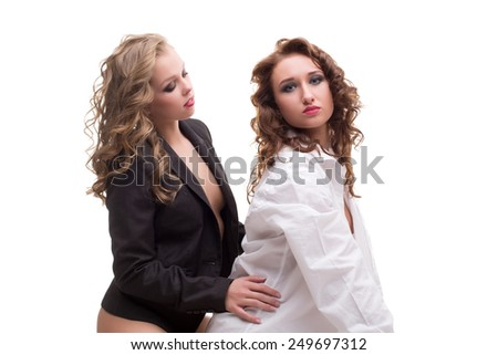 Image of charming bisexual women posing in studio - stock photo