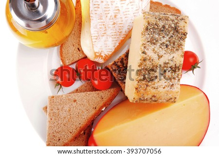 image of cheeses and olive oil on plate - stock photo