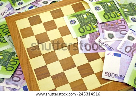 Image of chess board and euro money. Struggle and competition for money - stock photo