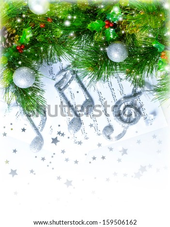 Image of Christmas treble clef on notes pages, beautiful melody, silver ornament on green fir tree border, traditional Christmas carol, New Year greeting card, musical sheet, Xmas decoration  - stock photo