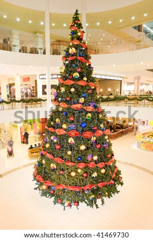 Image of Christmas tree decorated with colorful toy balls and garlands in the mall - stock photo