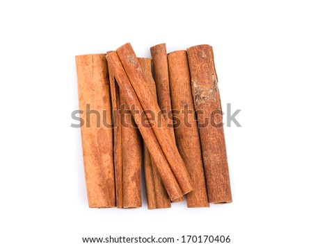 Image of cinnamon sticks top view, isolated on white background