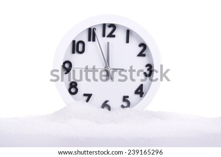 Image of Clock covered with snow isolated on white - stock photo
