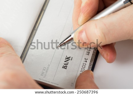 Image of Close up shot of a cheque with a pen - stock photo