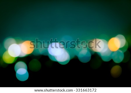 image of closeup blur bokeh light in city in green tone