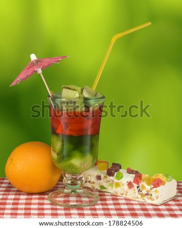 image of cocktail and cake on a green background
