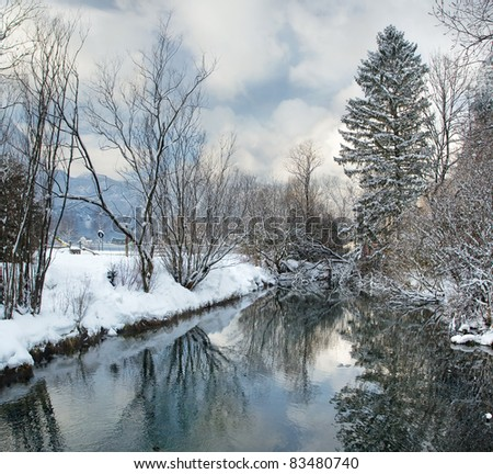 Image of cold and snowy winter in Austria. Beautiful mountain and nature at Hallstatt near Obertraun city opposite the Hallstatter See lake at foggy weather. On Christmas eve. - stock photo