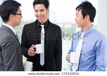 Image of colleagues having business coffee break - stock photo