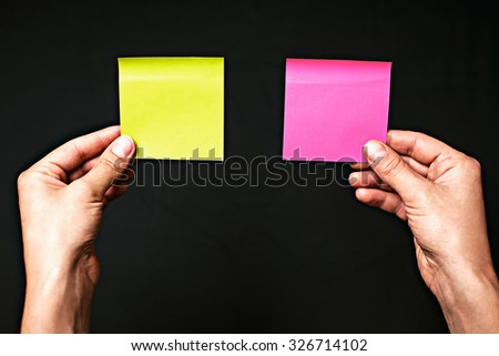 Image of colored stickers isolated on a black background. The concept of making the right choice, make the choice. - stock photo