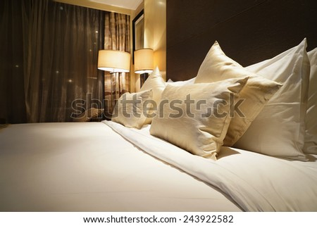 Image of comfortable pillows and bed - stock photo
