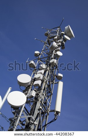 image of communication mobile internet antenna over a blue sky background - stock photo