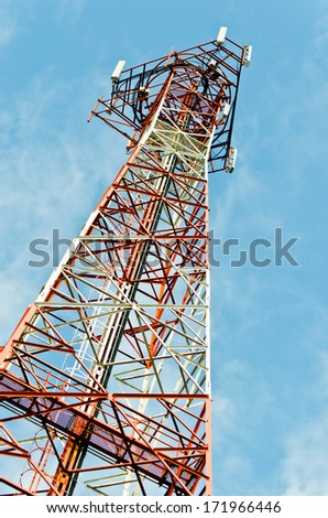 Image of communication pole with blue sky in background