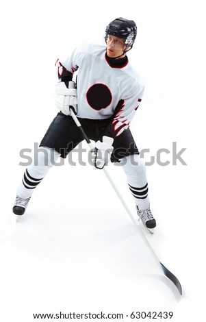 Image of concentrated hockey player during game - stock photo