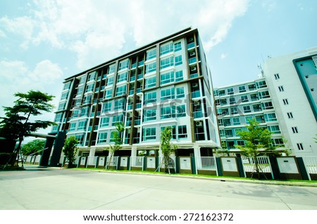 image of condo on afternoon with blue sky background.