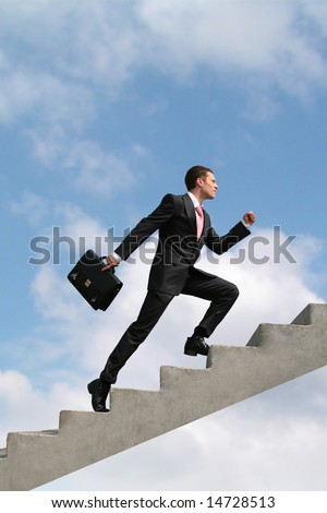 Image of confident businessman with briefcase walking upstairs - stock photo