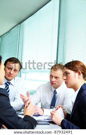 Image of confident colleagues communicating in office - stock photo