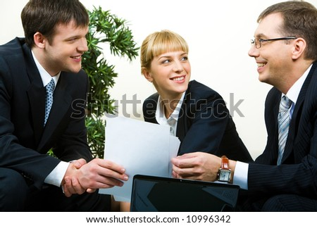 Image of confident man passing necessary agreement to the business partner