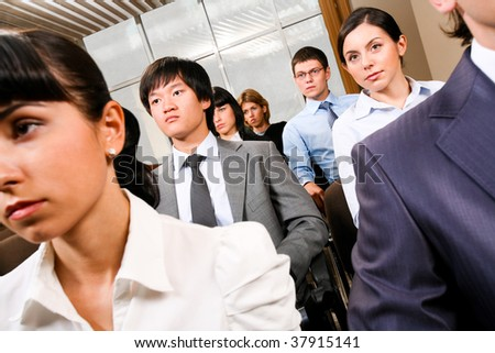 Image of confident people presenting at conference and listening to lecture - stock photo