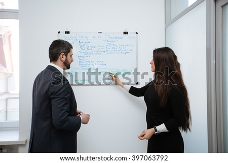 Image of confident woman making presentation and interacting with the audience - stock photo