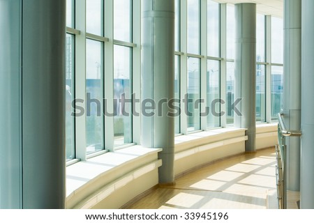 Image of corridor in office building with big windows passing daylight - stock photo