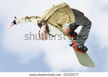 Image of courageous guy jumping on snowboarder in the air - stock photo
