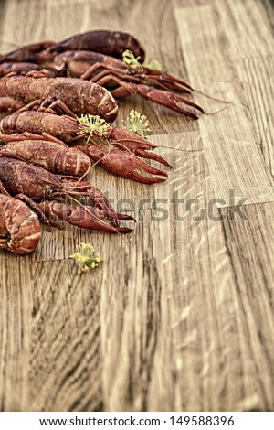 Image of crayfish on a wooden platter. - stock photo