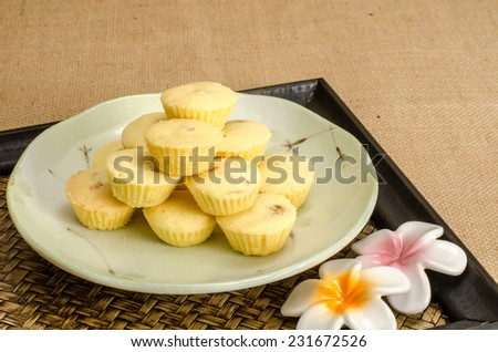 Image of cup cookie stuffed with pineapple in ceramic dish