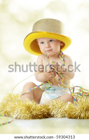 Image of cute baby with new year's decoration - stock photo