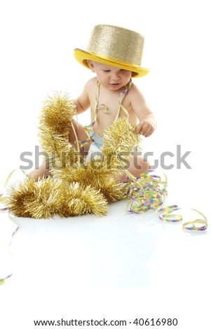 Image of cute baby with new year's decoration over white background - stock photo
