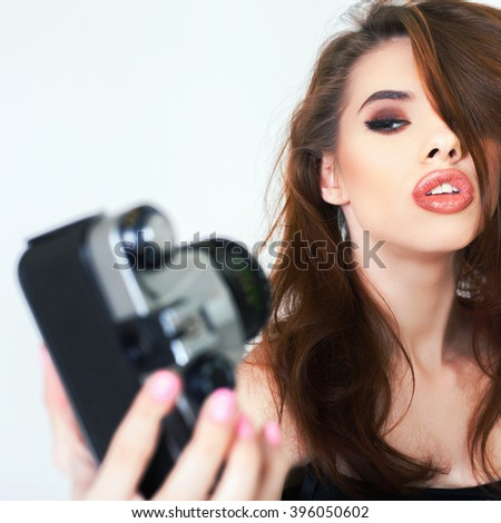 Image of cute girl make a photo selfie at vintage camera. Take a photograph of herself. Funny, party. Beauty. Happy girl smiling. Makeup and hairstyle - stock photo