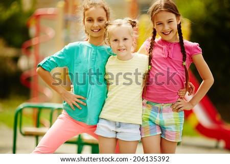 Image of cute girls posing on playground outdoors  - stock photo