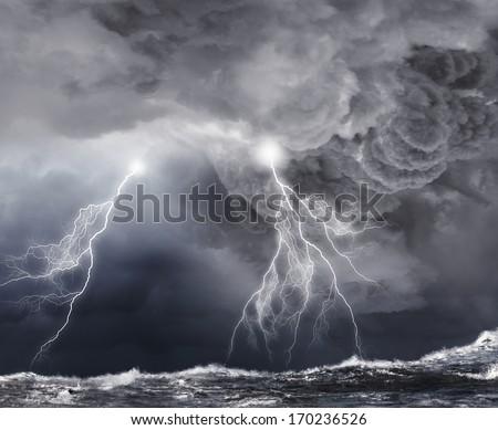 Image of dark night with lightning above stormy sea - stock photo