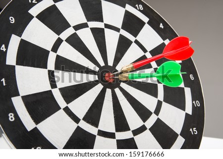 image of dart board with darts  - stock photo