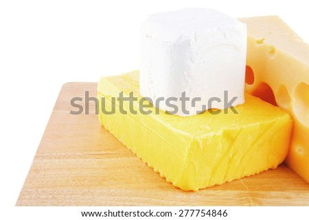 image of delicious cheeses served on wooden board - stock photo