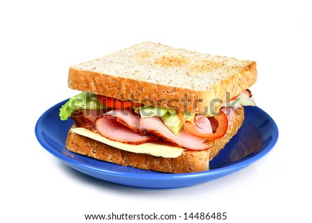 image of delicious ham sandwich with lettuce cheese and tomatoes