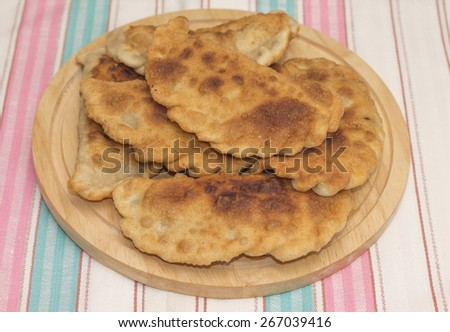 Image of delicious homemade meat pasties on cutting board - stock photo