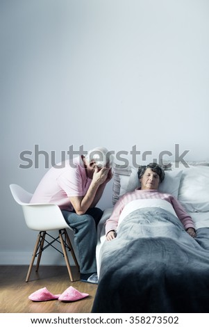 Image of despair husband and his dying wife - stock photo